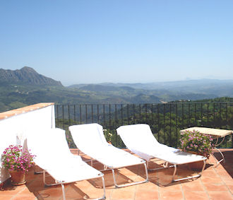 Sunny terrace with loungers and fantastic view